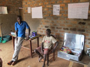 Bertin with Patrick, who provides one-to-one support.