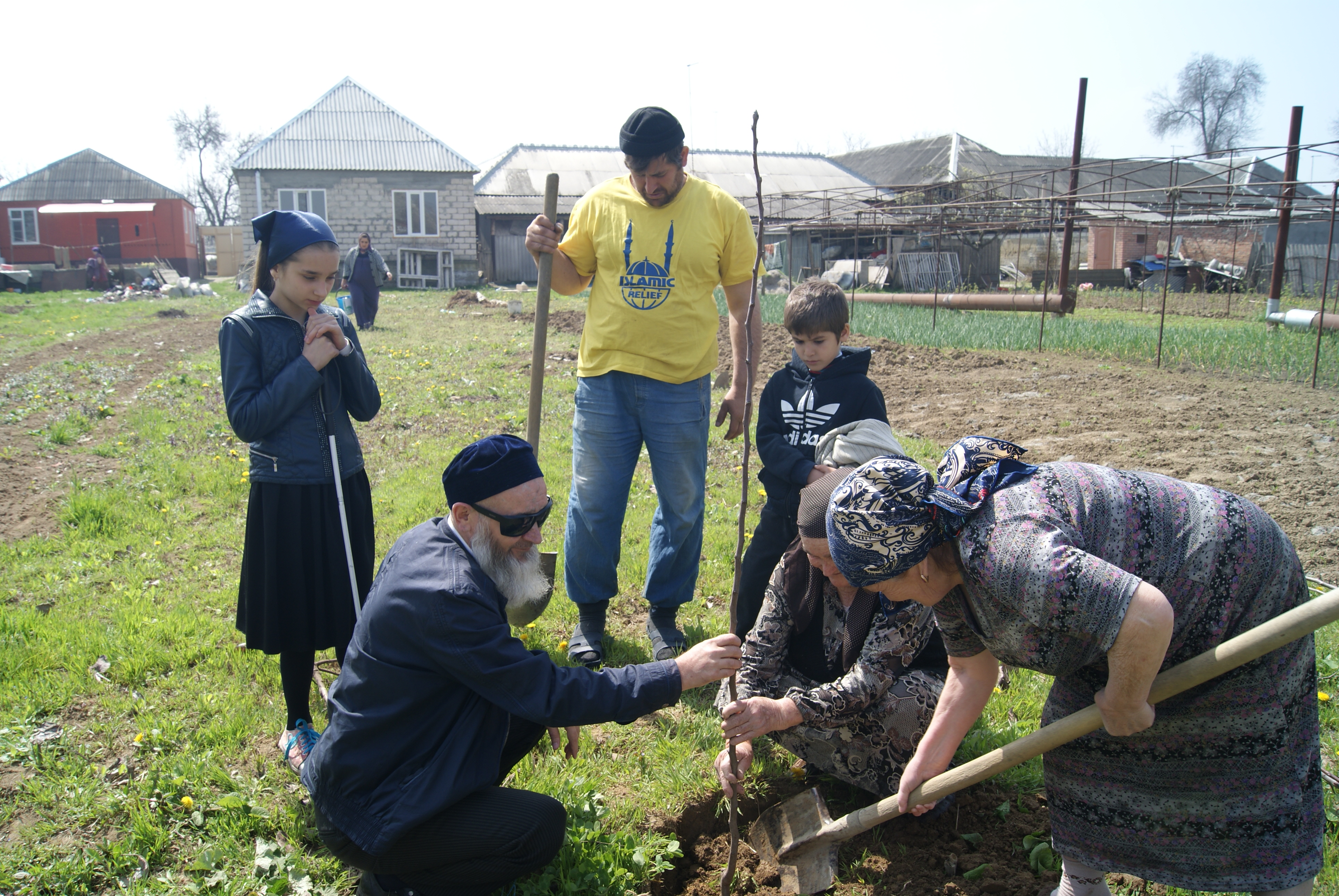 In the framework of the projecvt IRR distributed 1000 trees for the Blind,provided necessary gardening equipment, chemicals and professional consultations for cultivating various fruit trees. Daud Yusupkhadzhiev lives in Shali village, he is planting the tree under the supervision of membersfrom thegrass-root organization ofvisually handicapped, which is cooperating with IRR in implementing of this project.
