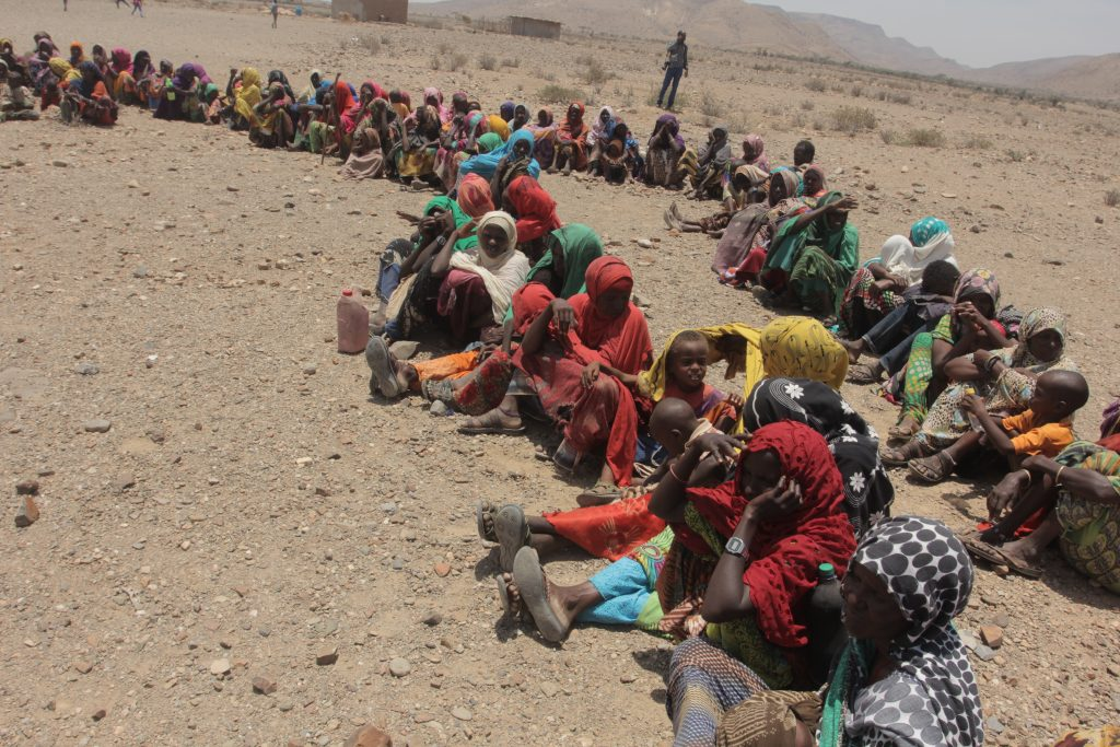 Pastoralists wait for food aid to arrive