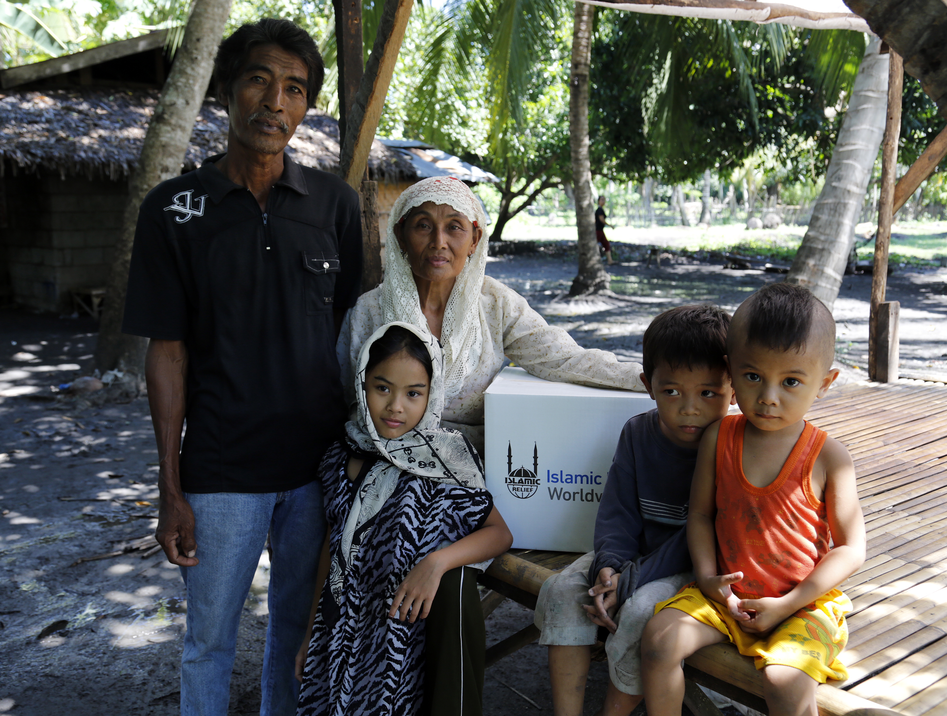 Samia Batua and her family at their home in Galakit, Pagalungan.